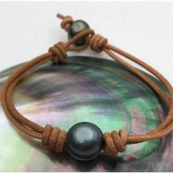 Braccialetto o Collana Cuoio perla nera di Tahiti 11-12 mm AA tra due nodi